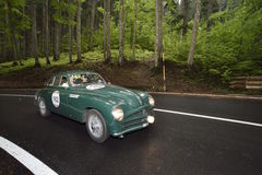 A green Stanguellini 1100 Berlinetta Bertone takes part to the 1000 Miglia classic car race Royalty Free Stock Photos