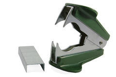 Green staple remover and staples. Darkly green staple remover and staples on a white background Stock Photography