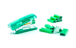 Green stapler and bunch of staples Stock Images
