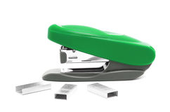 Green stapler. On a white background with brackets Stock Photography