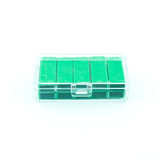 Green staples in box Stock Photography