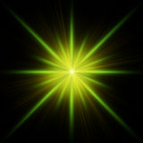 Green star flash with spikes Stock Photos