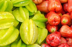 Green starfruit and bell fruits background display on fresh market Stock Image