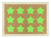 Green stars on cork notice board Royalty Free Stock Photo