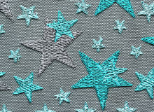 Green stars lace material texture macro shot Royalty Free Stock Photography