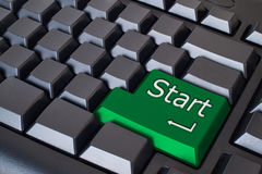Green start button. On Black keyboard Stock Photography