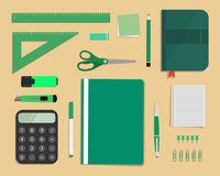 Green stationery on a beige background. Top view of a desk Stock Photography