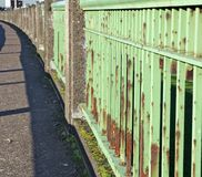 Green steel bridge railing Stock Image