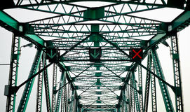 Green steel bridge with traffic signal Stock Photo