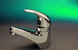 Green steel chrome designer faucet and tap. Green steel faucet Tap. With the resurgent and developing economies of  new millennium many people are increasingly Stock Photography