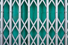 Green steel shutter gate Stock Photo