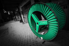 Green steel wheel for electrical conductor cable Stock Photo