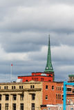 Green Steeple Under Stormy Skies Stock Images