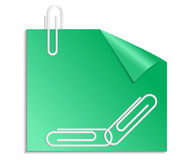 Green sticker with curled corner and paper clips Royalty Free Stock Image