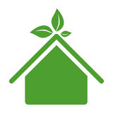 Green sticker house with leaves above the roof Stock Photo
