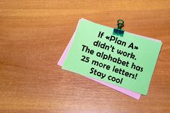 The green sticker with a paperclip, isolated on wooden background. If Plan a didn& x27;t work, the alphabet has 25 more letters. Stock Image