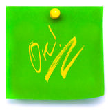 Green Sticker with yellow ok on a White Background Royalty Free Stock Images