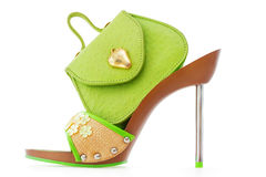 Green stiletto shoe and matching bag, on white Stock Photography