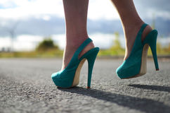 Green Stiletto shoes on woman's feet. Green high heel shoes in summer sunshine of Florida royalty free stock photos