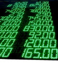 Green stock numbers (prices), led panel, exchange. Pile of stock numbers (green color) on black background. share prices on electronic lcd led display, ticker Royalty Free Stock Photo
