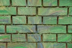 Green stone texture of bricks in the wall of the house Stock Photos
