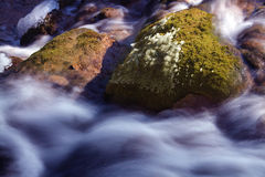 The green stone on water. The green stone below the waterfall in Jiuzhaigou Stock Images