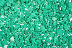 Green Stones. Little coloured stones on isolated background royalty free stock images