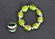 Green stones bracelet and ring isolated Royalty Free Stock Images