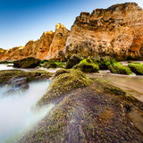 Green Stones at Porto de Mos Beach in Lagos, Algarve Royalty Free Stock Photography