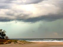 Greenish storm clouds over Stumers Creek COOLUM Beach. Green storm clouds over Stumers Creek COOLUM Beach stock photography