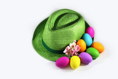 Green straw hat with easter colorful  eggs Royalty Free Stock Photo