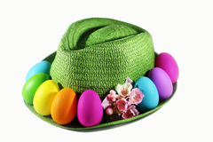 Green straw hat with easter colorful  eggs Stock Photos
