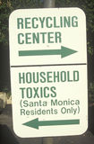 A green street sign designating recycling areas at the Santa Monica Community Center royalty free stock photo