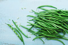 Green or string beans on blue vintage table top view. Organic and healthy food. Farmers autumn harvest. Green or string beans on blue vintage table top view stock photography