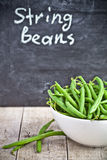 Green string beans in a bowl. And blackboard Royalty Free Stock Photos