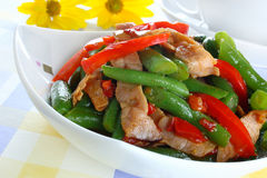 Green string beans with ham. And paprika Stock Photo