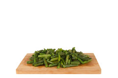 Green string beans on a wooden board. On a white background Royalty Free Stock Photos