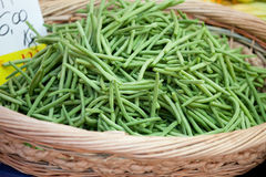 Green string beans in woven basket close-up Royalty Free Stock Photos