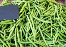 Green String French Beans on sale on market, top view. Natural Pattern and Background stock image