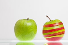 Green and striped apple Royalty Free Stock Photos