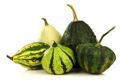 Green, striped and beige ornamental pumpkins Royalty Free Stock Images