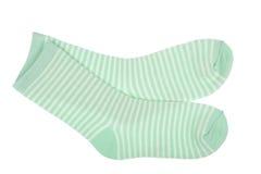 Green striped childish socks isolated. Stock Photo