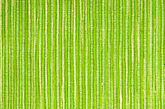 Green fabric background. Green striped cotton fabric background, rough texture stock image