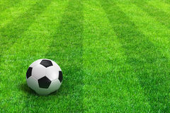 Green striped football field with soccer ball. Close view of green striped football field with soccer ball Stock Image