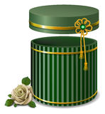 Green striped  gift box and white rose on  retro style . Royalty Free Stock Image