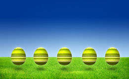 Green striped pattern Easter Egg with blue sky and Stock Photo