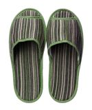 Green striped slippers isolated on white background. Close up, high resolution Royalty Free Stock Photo