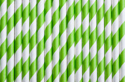 Green stripped paper straws for cocktails pattern background Royalty Free Stock Images