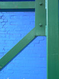 Green structure on a blue wall Royalty Free Stock Photography