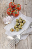 Green stuffed spicy olive on white paper Royalty Free Stock Images